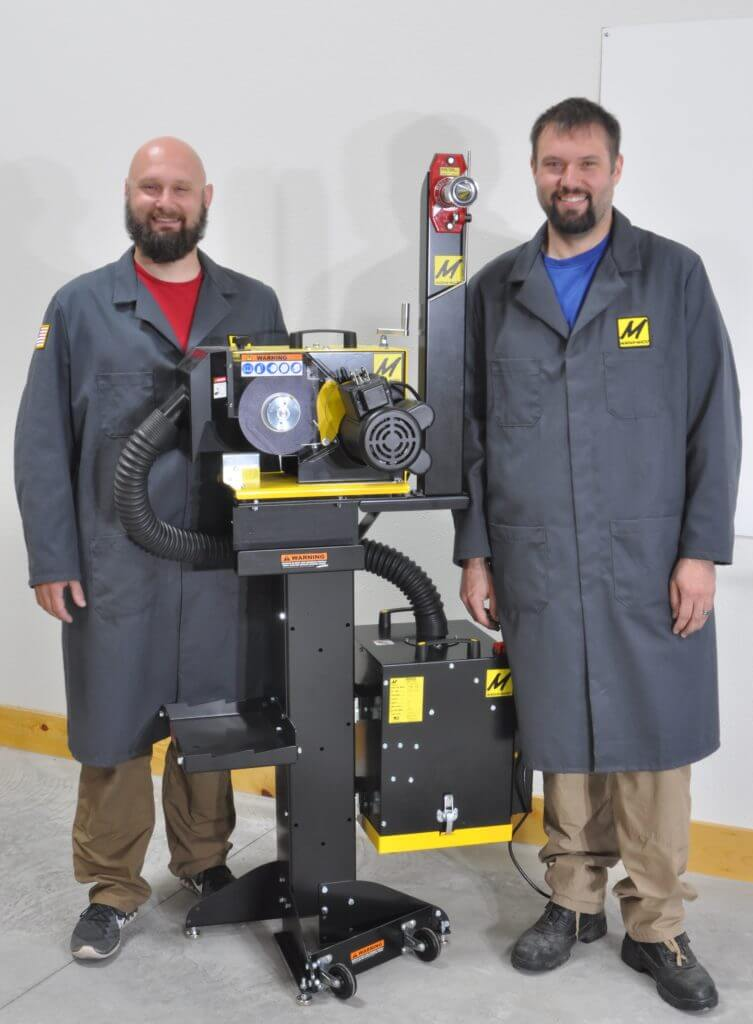 Gerd Bauer and Erik Bauer next to their Lawn Mower Blade Sharpener with its balancer and dust collector.