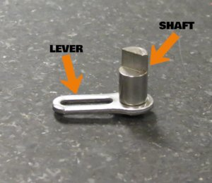 Complex metal part with shaft and lever