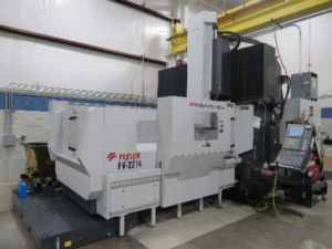 35hp motor, 50 taper spindle (2 speed, 10,000 max rpm) and 55″ x 85″ table