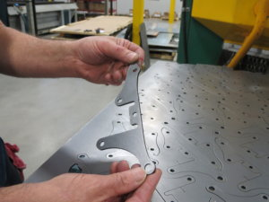 Meeting customer specifications for metal parts in the laser cutter