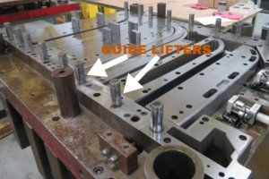 Die lifters on a production tooling die