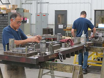 Experienced Toolmakers and apprentices working together to deliver higher quality stamping dies