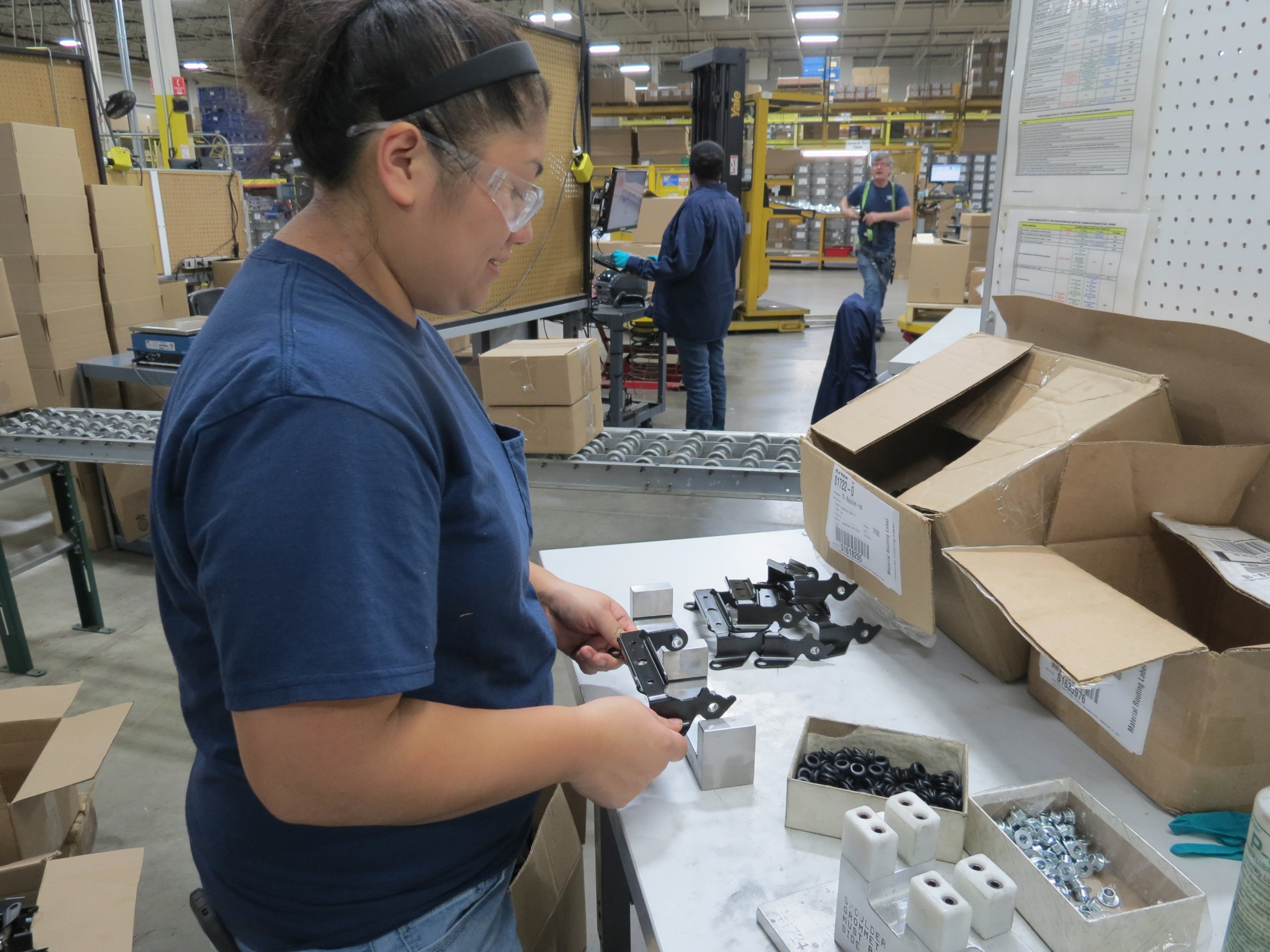 inspecting metal parts with quality gauges